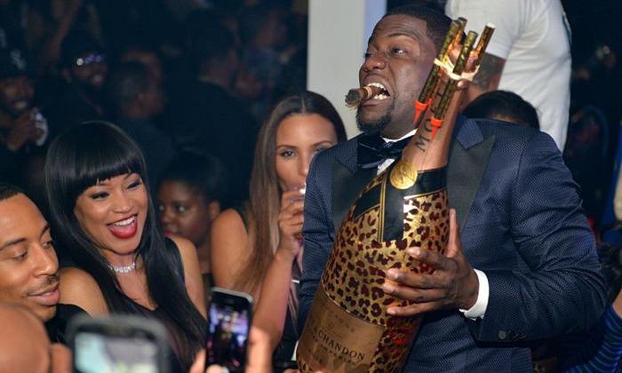 Kevin Hart with Moet NIR Leopard bottle THUMB