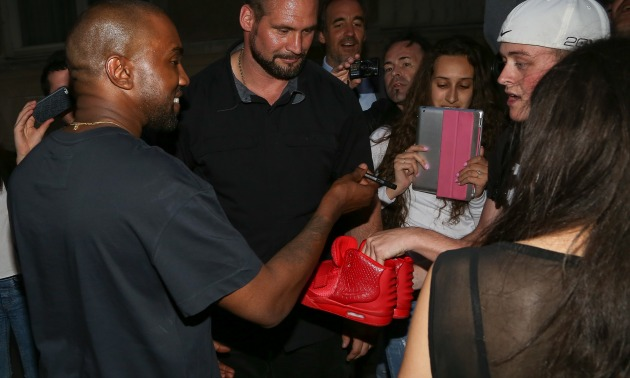 Kanye West Signing Sneakers.jpg