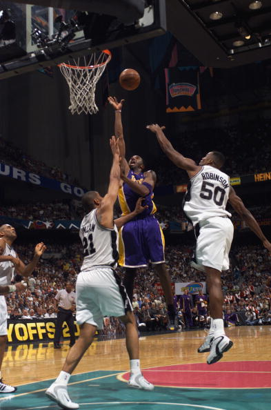 Kobe Bryant shoots over Tim Duncan and David Robinson