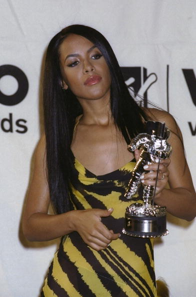 Aaliyah shows her award for Best Female Video From a Film ba
