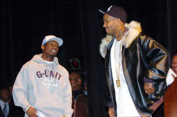 Rappers 50 Cent (left) and The Game share the stage during a