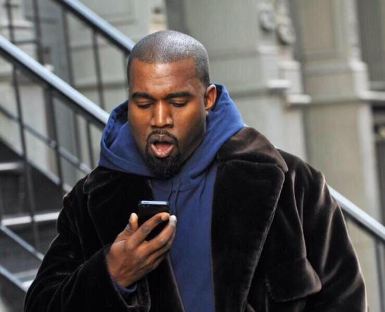 kanye looks at phone