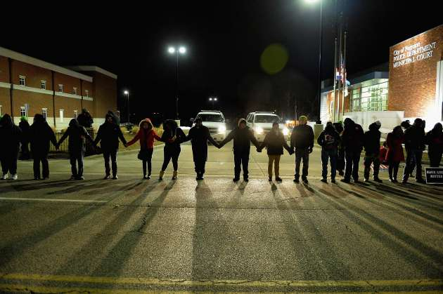 Protestors demonstrate in front of Ferguson Police Station