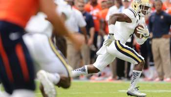 CHARLOTTSVILLE, VIRGINIA AUGUST 30, 2014-UCLA's Ishmael Adams returns an interception for a touchdow