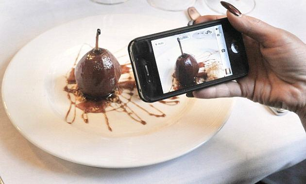 Woman Taking Picture of Food