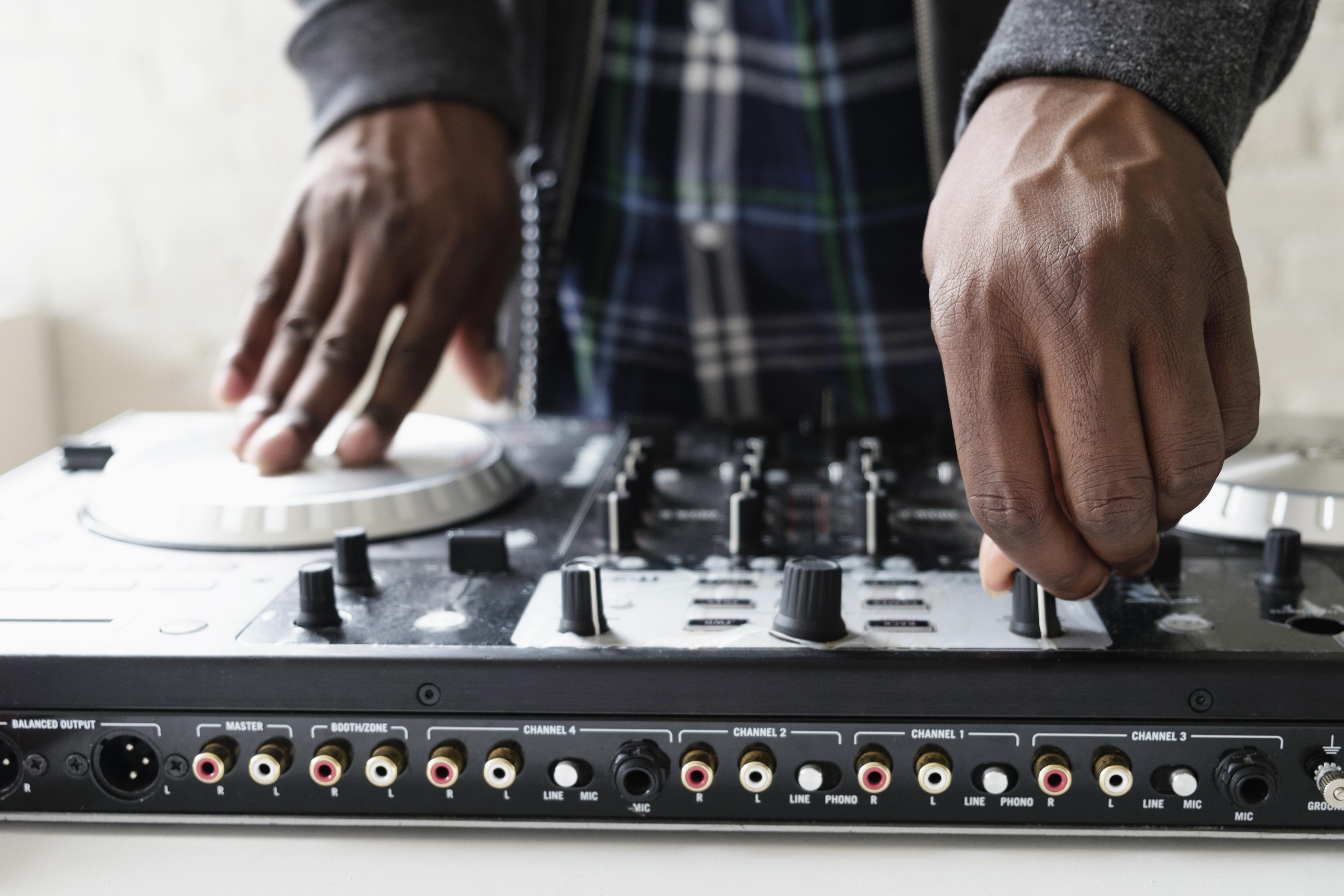 DJ using mixing desk, close up