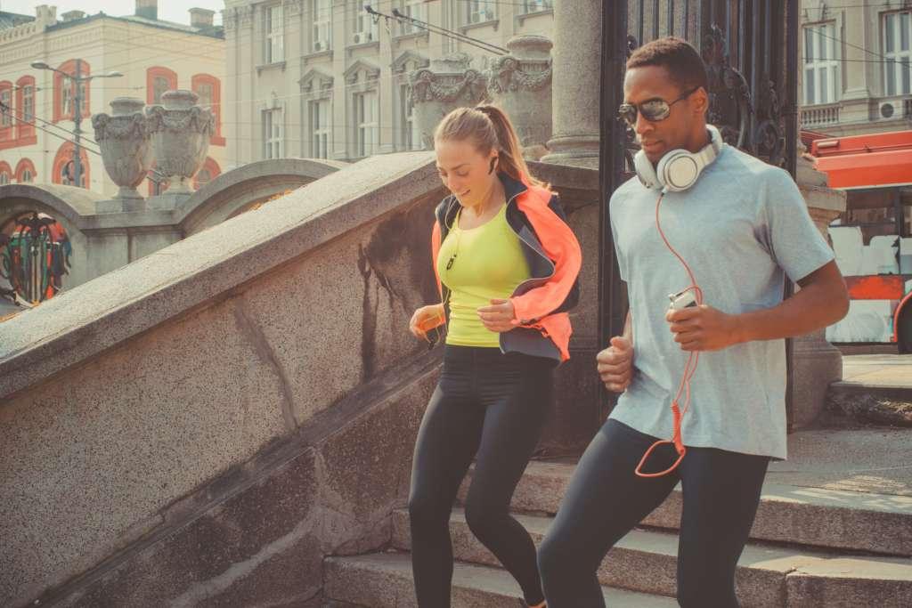couple jogging on street