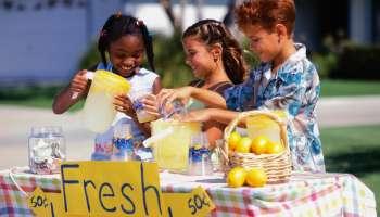 Children Selling Lemonade at Lemonade Stand