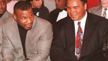 Former heavyweight boxing champion Mike Tyson (L)