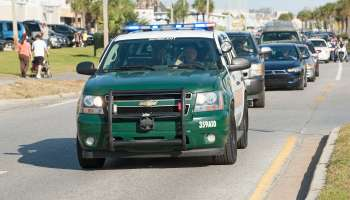 Sergeants car of the Sheriffs Department driving on a blue light Florida USA