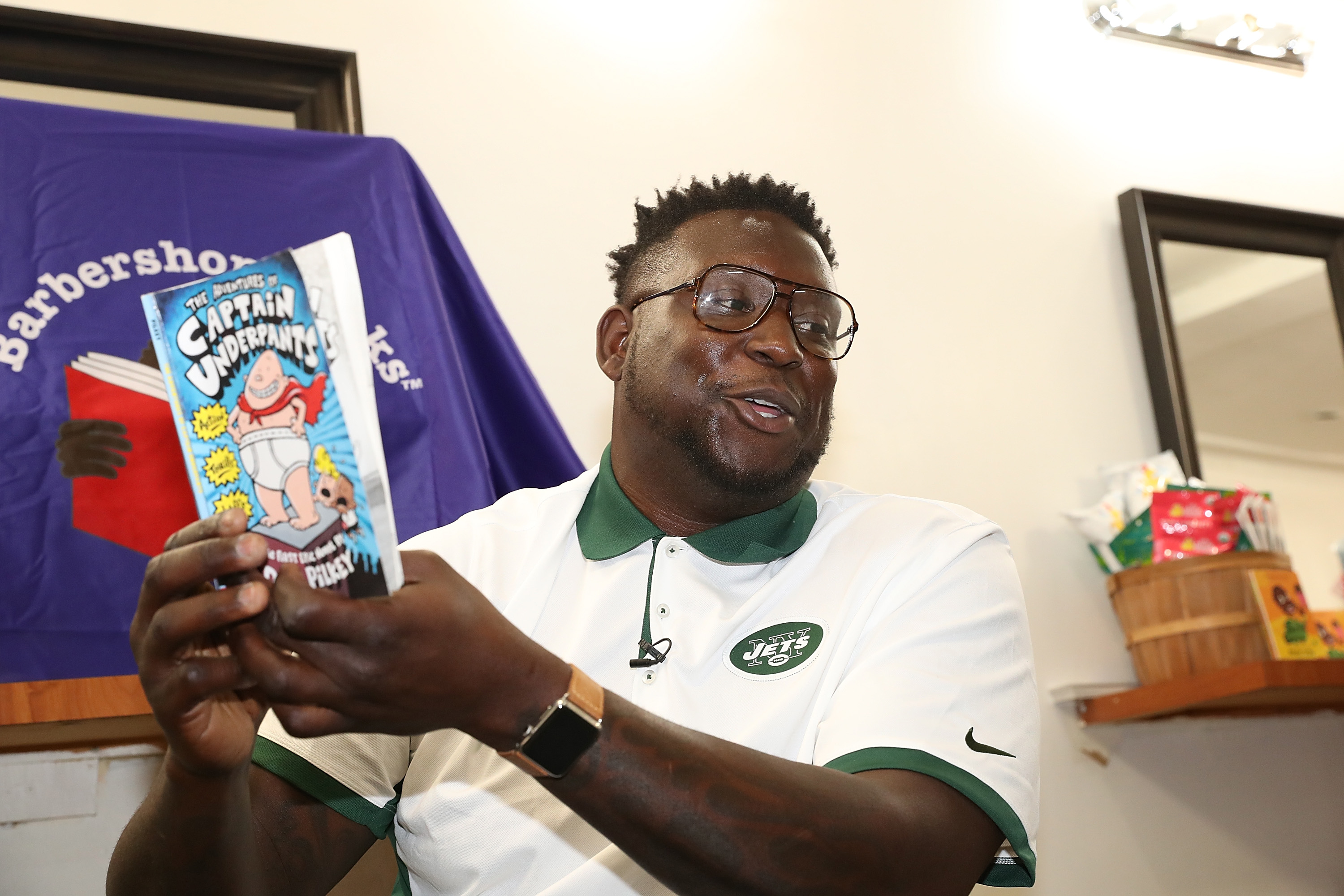 NFL Player Jarvis Jenkins Youth Reading Event The International Hair Studios Harlem