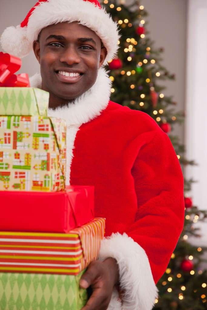 USA, Illinois, Metamora, Santa Claus with stack of gifts
